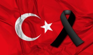 black ribbon on flag of tuekey in memory of victims of terrorist attack.